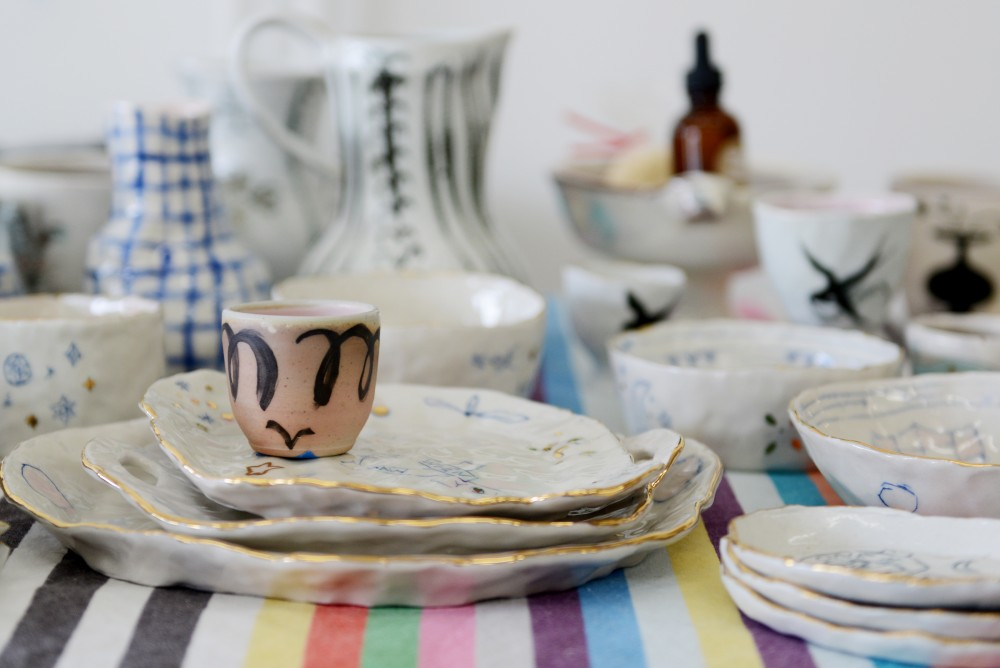 The White Page, a local art gallery, hosted its 3rd artist market over the weekend with 23 local artists, including ceramics created by Stephanie DeArmond.