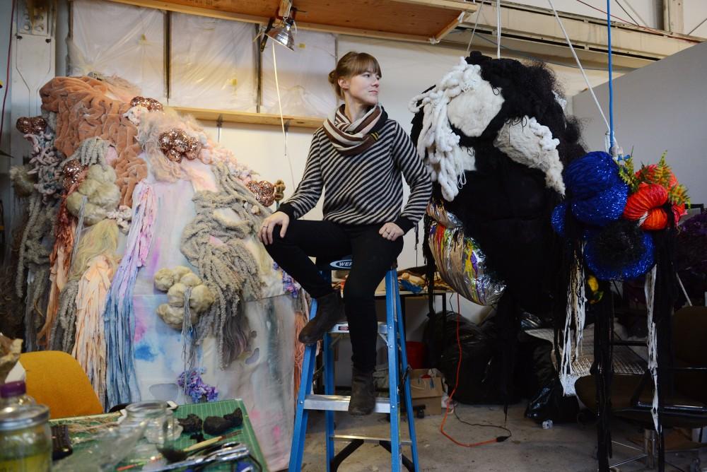 Visual artist and University adjunct Professor Kate Casanova poses with pieces in her Spectra series in her studio in Northeast Minneapolis on Wednesday, Dec. 7, 2016.