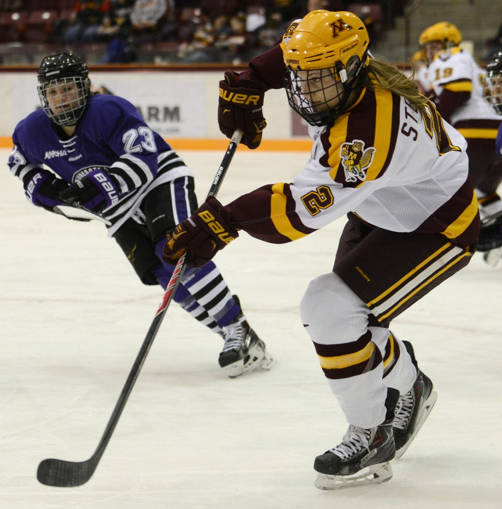 Gophers defenseman Lee Stecklein skates with the puck from Minnesota State-Mankato's Katie Johnson on Jan. 16, 2015 at Ridder Arena.