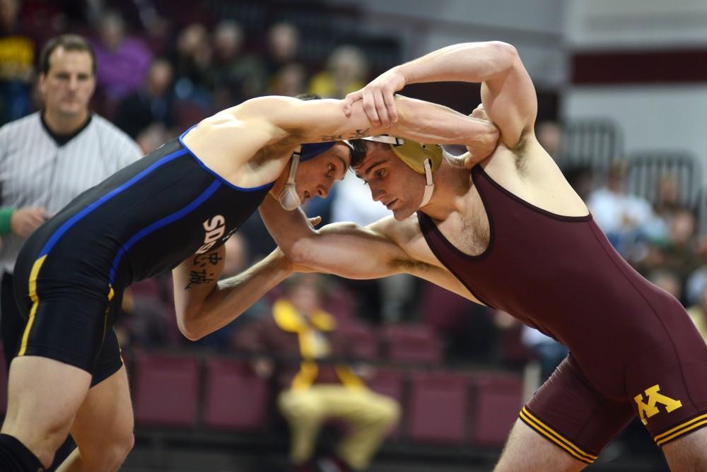 Gophers wrestler Jake Short competes in the wrestling teams home opener at the Sports Pavilion on Nov. 19, 2016.
