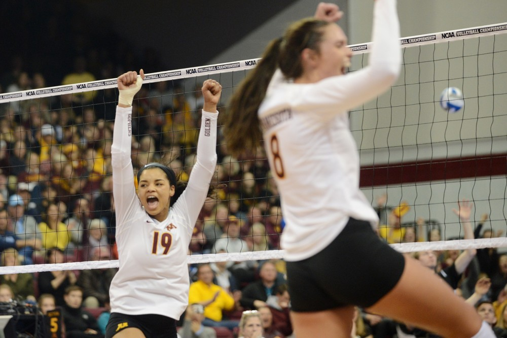 Outside hitters Alexis Hart, left, and Sarah Wilhite, right, celebrate a point for the Gophers on Friday, Dec. 9, 2016 at the Sports Pavilion during their NCAA Regional semi-final game against Mizzou.