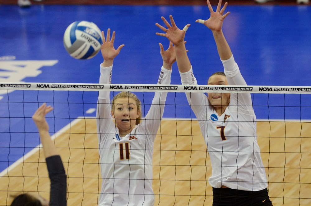 Setter Samantha Seliger-Swenson, left and middle blocker Hannah Tapp, right, attempt to block the ball on Friday, Dec. 9, 2016 at the Sports Pavilion during the Gophers NCAA Regional semi-final game against Mizzou.