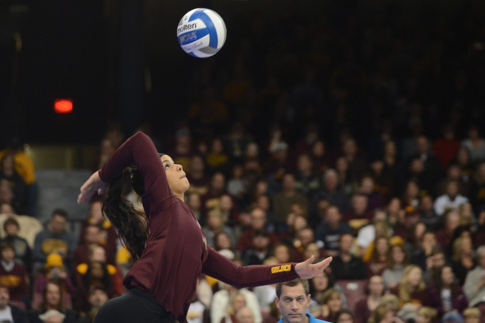 Defensive specialist Dalianliz Rosado serves the ball on Friday, Dec. 9, 2016 at the Sports Pavilion during the Gophers NCAA Regional semi-final game against Mizzou.