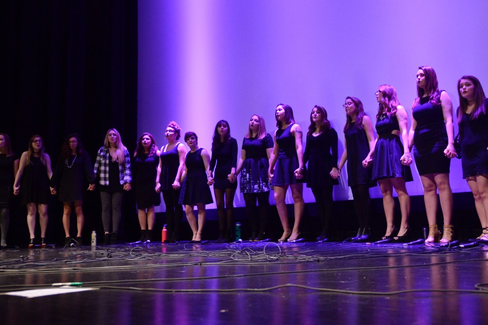 The Enchantments sing with alumnae during their 10th Birthday Concert at Coffman Memorial Union on Dec. 12, 2016. The all-female a cappella group was founded in 2006.