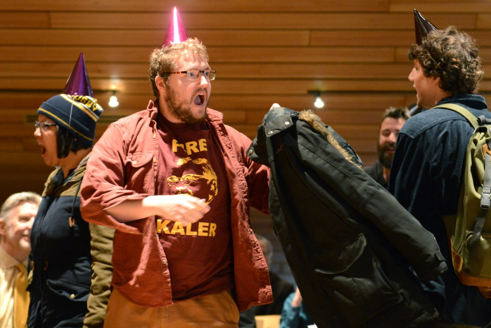Protester Matt Boynton chants as they are escorted from McNamara Alumni Center on Friday, Dec. 9, 2016. Students for a Democratic Society protested the Board of Regents meeting.