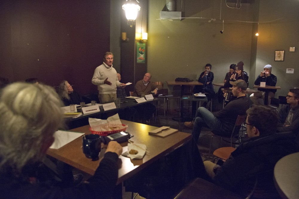 Randal Gast, co-owner of Qdoba Mexican Eats in Dinkytown and Dinkytown Business Alliance member, speaks at a town hall about affordable housing and Dinkytown development on Wednesday, Dec. 7, 2016 at the Purple Onion Cafe. MSA hosted the town hall for students and members of the Dinkytown community to discuss their concerns about development in the area.