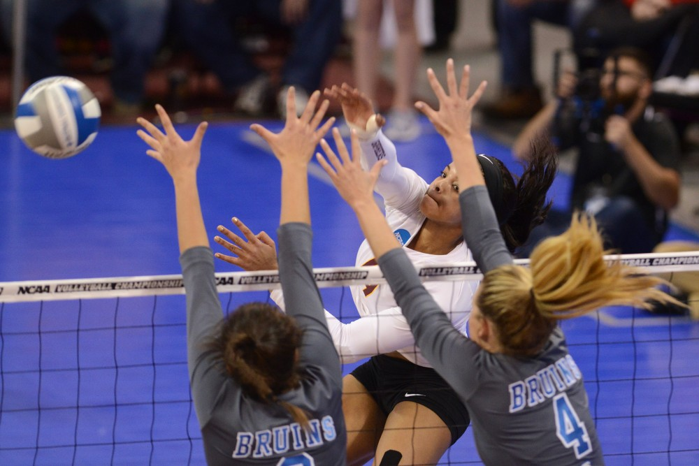 Outside hitter Alexis Hart pushes the ball past UCLA in the Sports Pavilion on Saturday, Dec. 10, 2016.