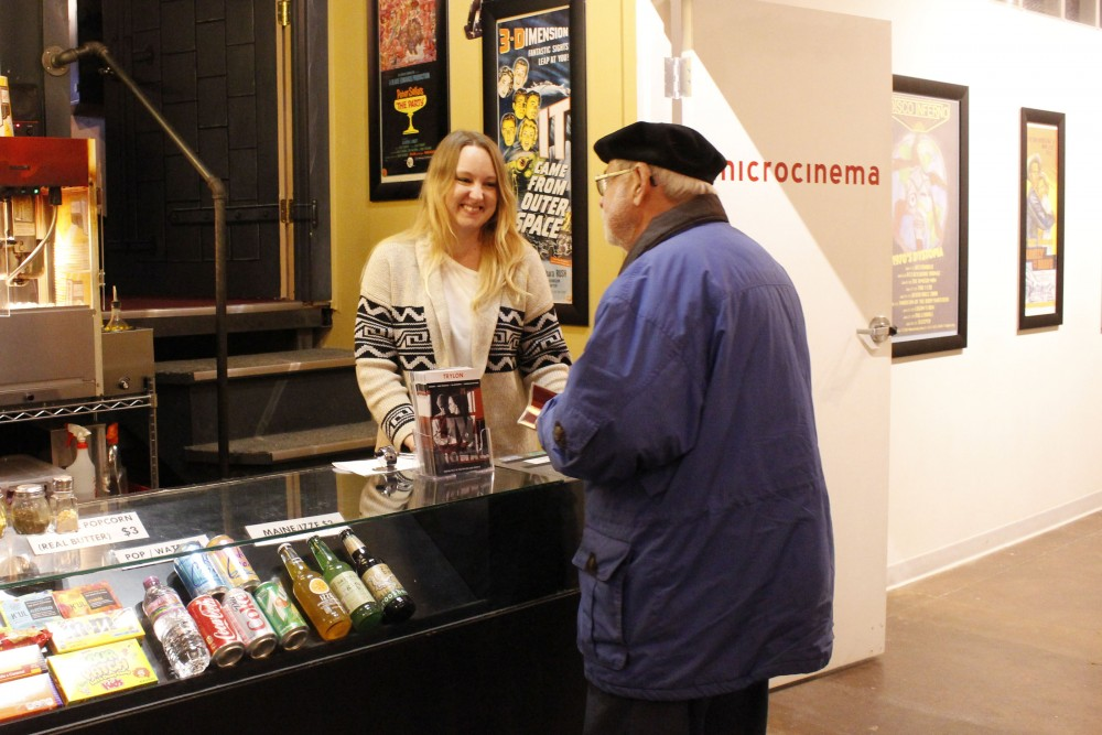 Caitlyn Dibble helps a customer before the start of a film at Trylon Microcinema in Minneapolis on Friday, Dec. 9, 2016.
