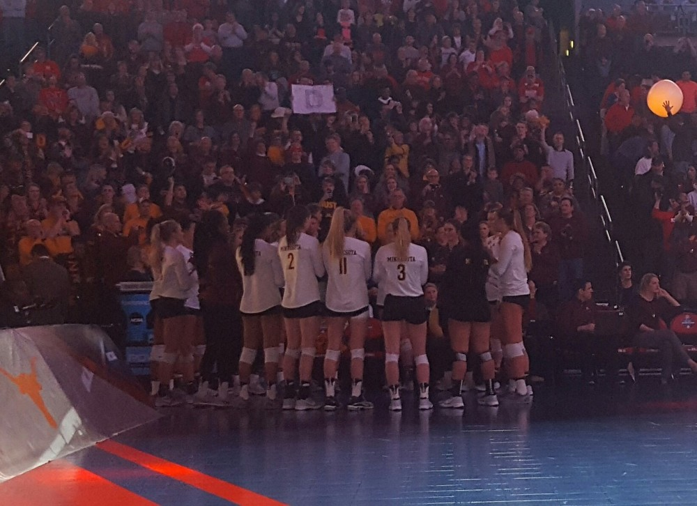 The Gophers volleyball team huddles up in preparation for the national semifinal match on Dec. 15. Minnesota lost 3-1 to Stanford in its second consecutive Final Four.