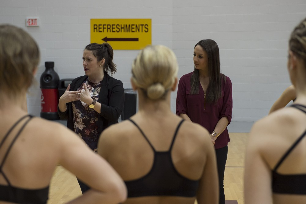 Dance team coach Amanda Gaines, left and assistant coach Ashley Hanne, right, speak with their team during a practice on Monday, Jan. 9, 2017 prior to their prior to their performance at the Spirit Squad Nationals Send Off.