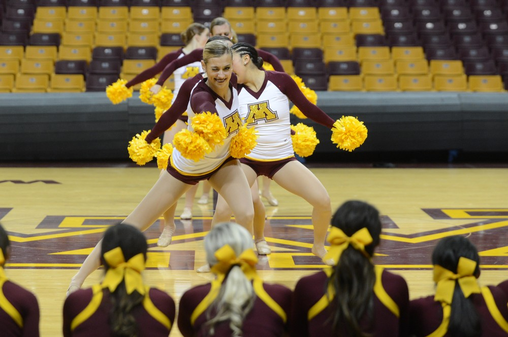 Members of the cheer teams line the stage as the University of Minnesota Dance Team preforms their pom routine on Monday, Jan. 9, 2017 during the Spirit Squad Nationals Send Off.