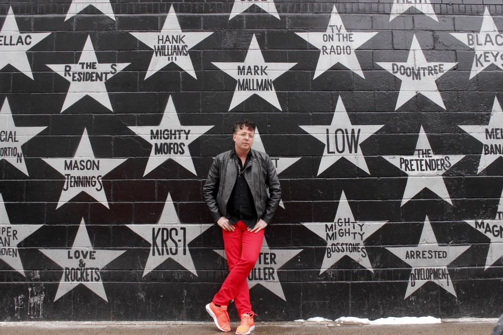 Mark Mallman poses for a portrait with his star at First Avenue in Minneapolis on Monday, Jan. 16, 2017.