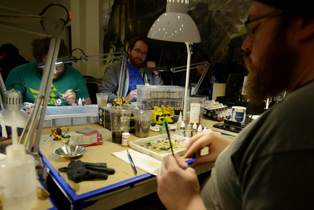 David Pease paints figurines for the steampunk horror game, Malifaux, at Fantasy Flight Games in Roseville on Jan. 16, 2016. The center hosts a variety of activities and competitions for tabletop game enthusiasts in the Twin Cities.