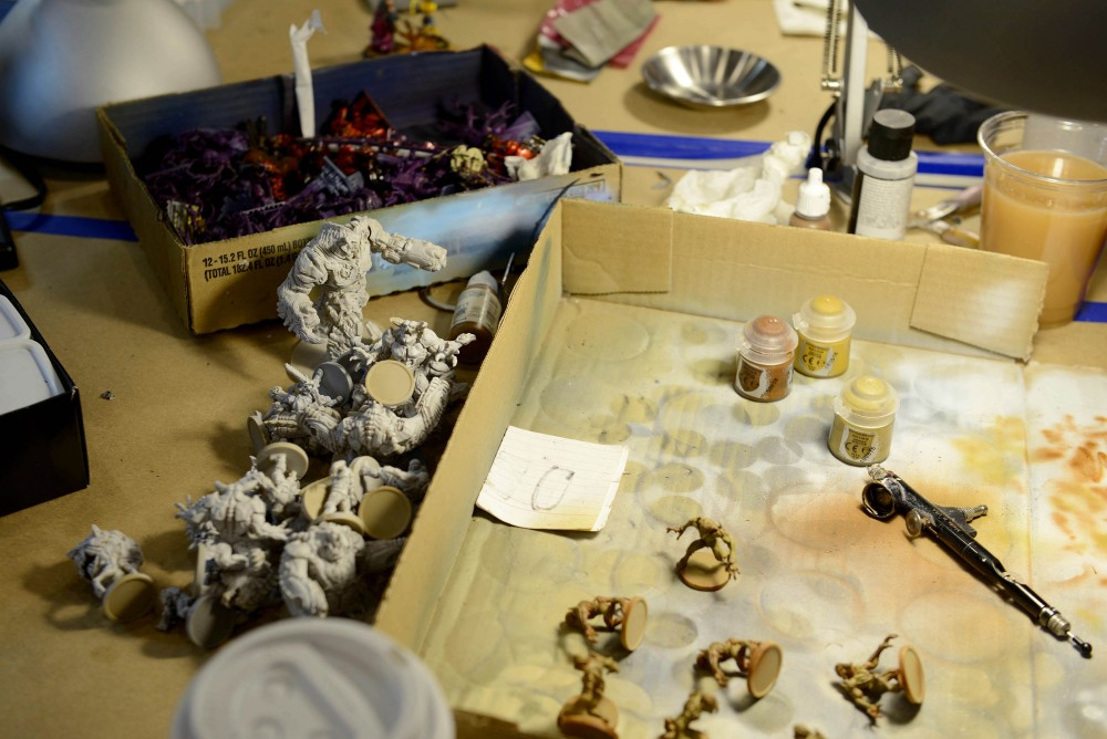 Figurines in the process of being painted sit on a table at Fantasy Flight Games in Roseville on Jan. 16, 1016. The center hosts a variety of activities and competitions for tabletop game enthusiasts in the Twin Cities.