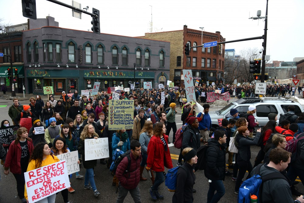 Demonstrators march through the Cedar-Riverside neighborhood to protest the election of President Donald Trump on Friday, Jan. 20, 2017.