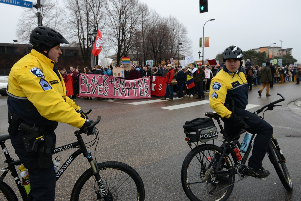 Minneapolis Police Officers block traffic to protest protesters outside of the Minneapolis American Indian Center on East Franklin Avenue on Friday, Jan. 20, 2017.