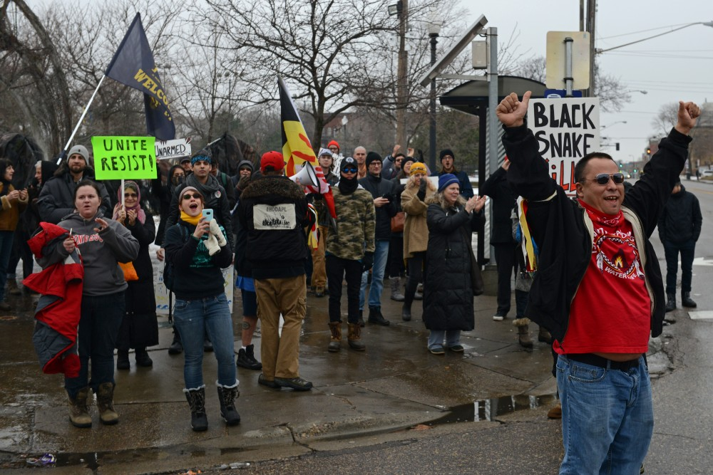 Demonstrators from the Black Snake Resistance March cheer as the group of student protesters arrives to join them at the intersection of East Franklin Avenue and Chicago Avenue on Friday, Jan. 20, 2017.