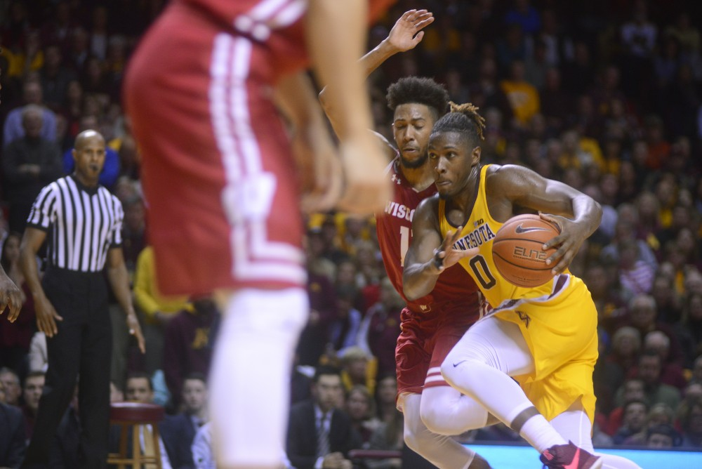 Gophers guard Akeem Springs drives toward the basket against Wisconsin on Jan. 21, 2017, at Williams Arena.