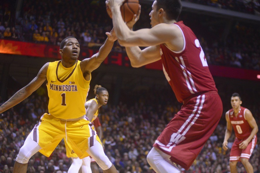 Gophers guard Dupree McBrayer puts his hand up to block a shot against Wisconsin on Jan. 21, 2017, at Williams Arena.