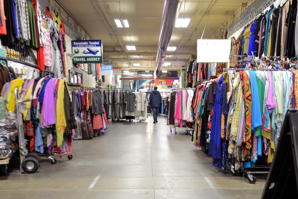 A shopper walks through a strip of stores on Tuesday Jan. 24. at Village Market in Minneapolis.