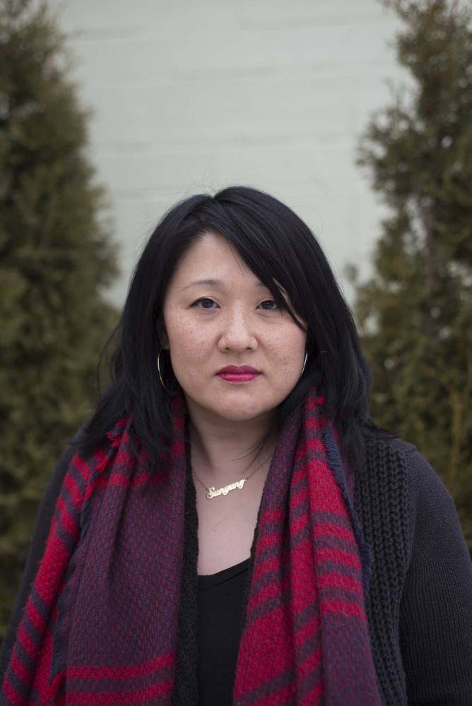 Minneapolis based poet Sun Yung Shin poses for a portrait outside the Roosevelt Library in Minneapolis on Saturday, Jan 21.