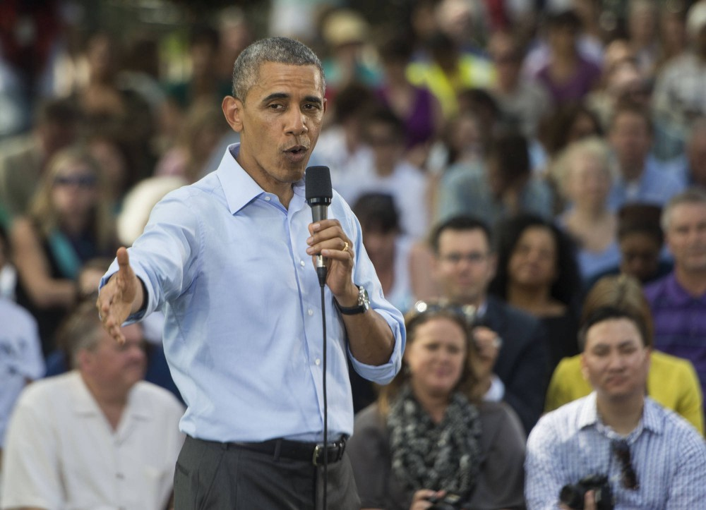 Former President Barack Obama addresses a crowd during a Town Hall meeting held at Minnehaha Park on June 27, 2014.