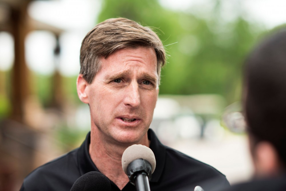 University director of athletics Mark Coyle speaks with the press at the Crow River Golf Club in Hutchinson, Minn on June 1. This was the first stop of the Gopher Road Trip Chalk Talk where University coaches talk about the upcoming season with fans and the press.