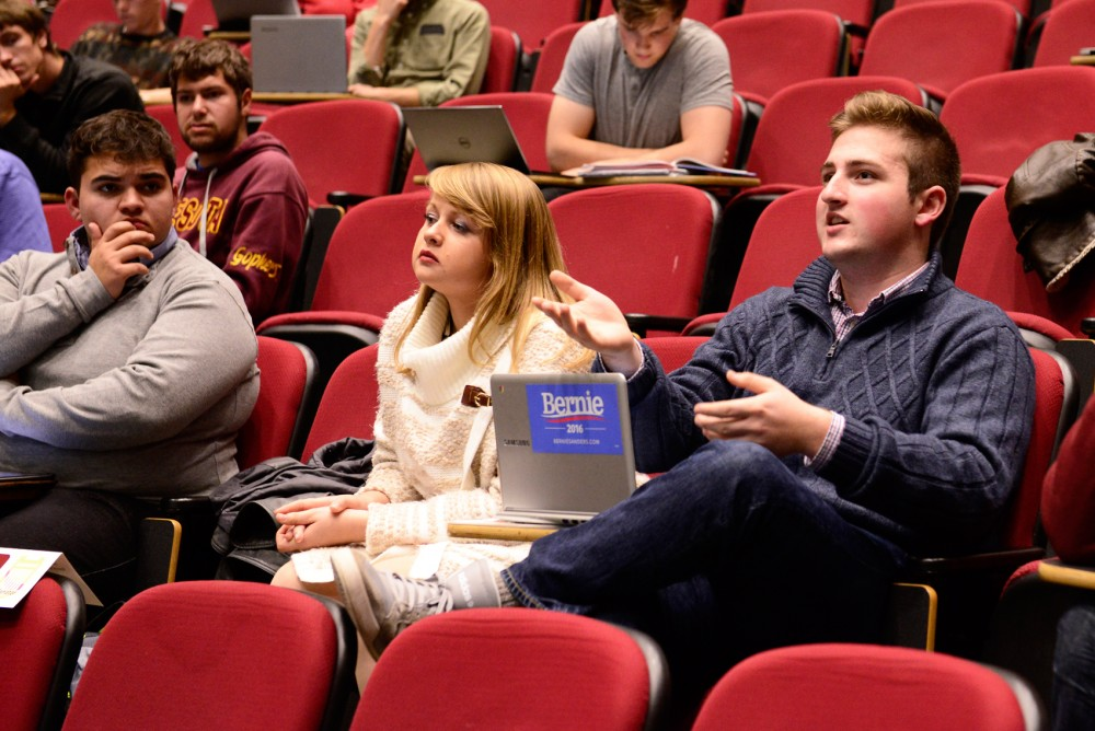 Sophomore Tom Wyatt-Yerka poses a question to Director of Undergraduate Student Initiatives LeeAnn Melin about the undergraduate advising process during the MSA meeting in the Molecular and Cellular Biology building on Tuesday, Oct. 27.