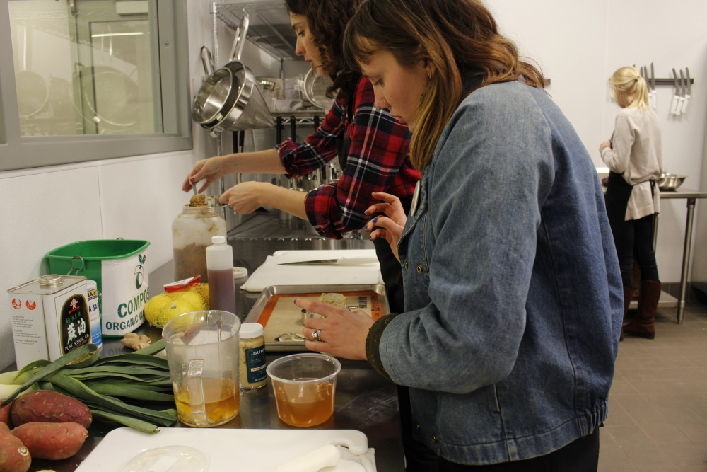 Calah Petriuusi and Bridget Love make a sauce for the vegetables at The Good Acre in St. Paul on Wednesday. Jan, 17. 2017.