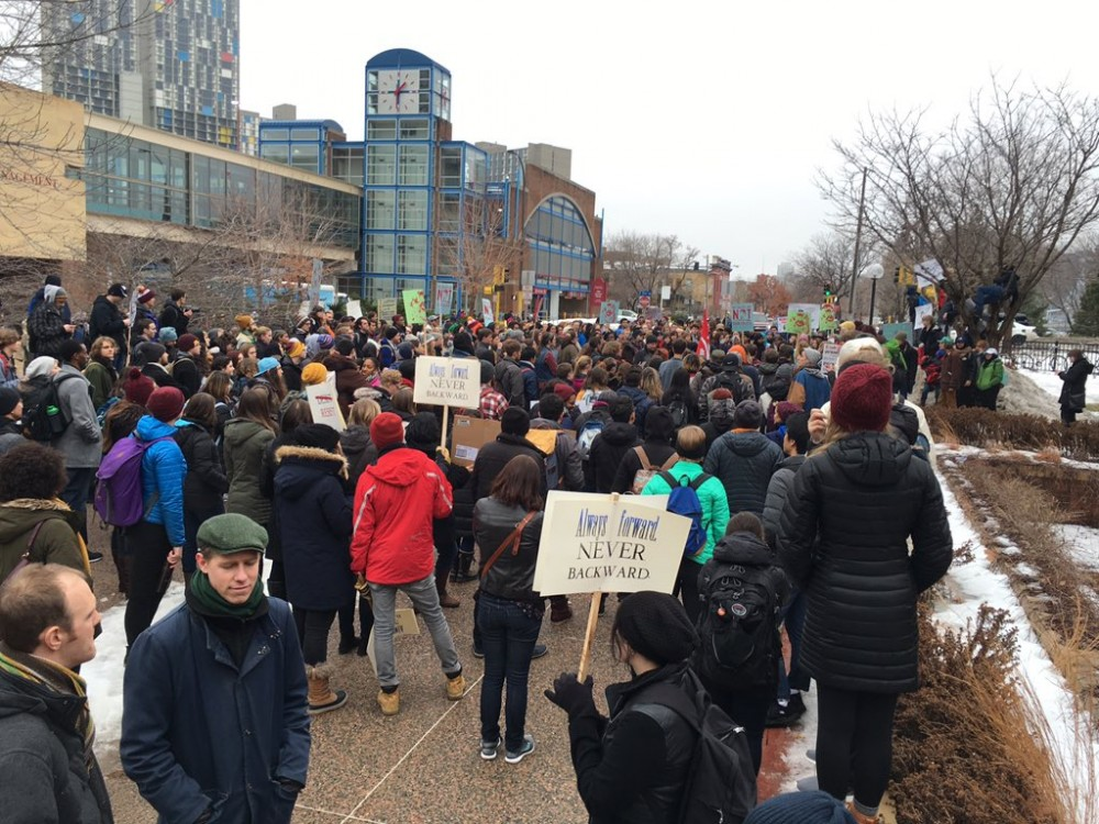 Roughly 200 to 300 people at University of Minnesota including students walked out in protest of President Donald Trump on Jan. 20.