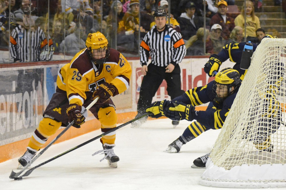 Gophers forward Justin Kloos controls the puck while playing against Michigan at Mariucci Arena on Feb. 26, 2016.