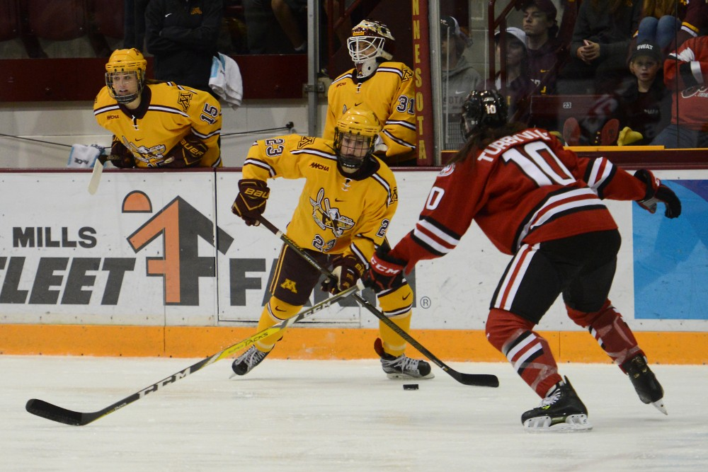 Junior forward Caitlin Reilly handles the puck at Ridder Arena on Oct. 29, 2016, where the Gophers beat St. Cloud State 3-0.