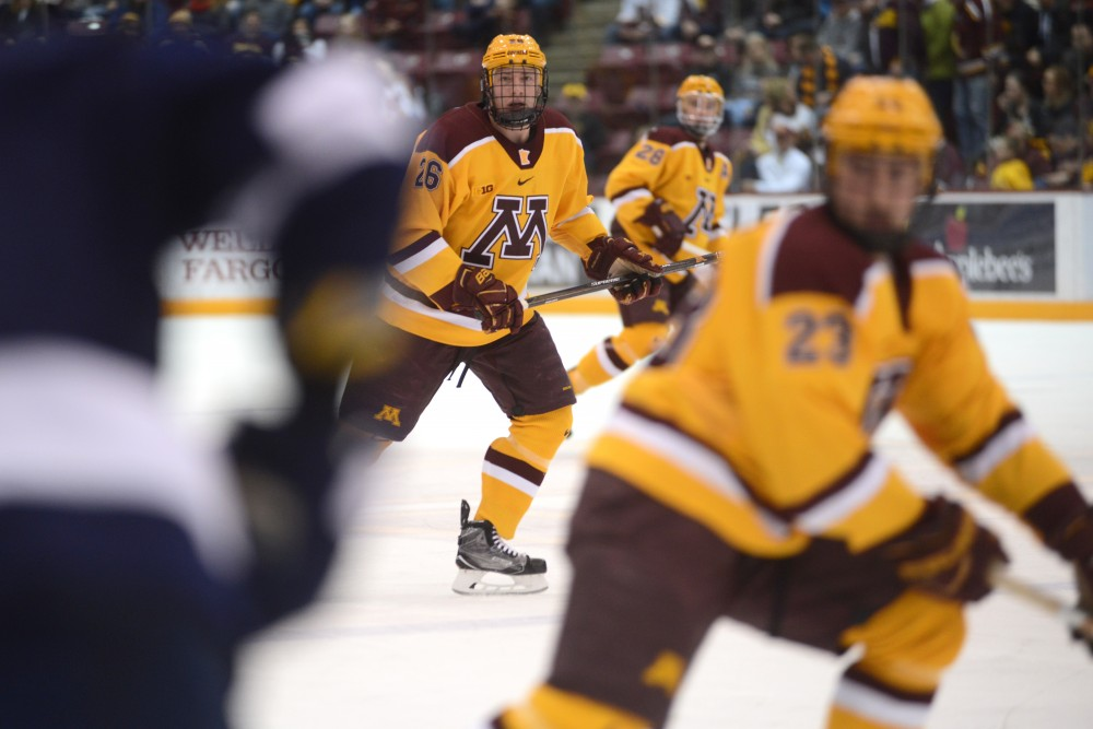 Darian Romanko, cente, eyes the puck at Mariucci Arena in Minneapolis on Friday, Feb. 4, 2017. The Gophers beat Penn State 5-2 for their sixth consecutive win.