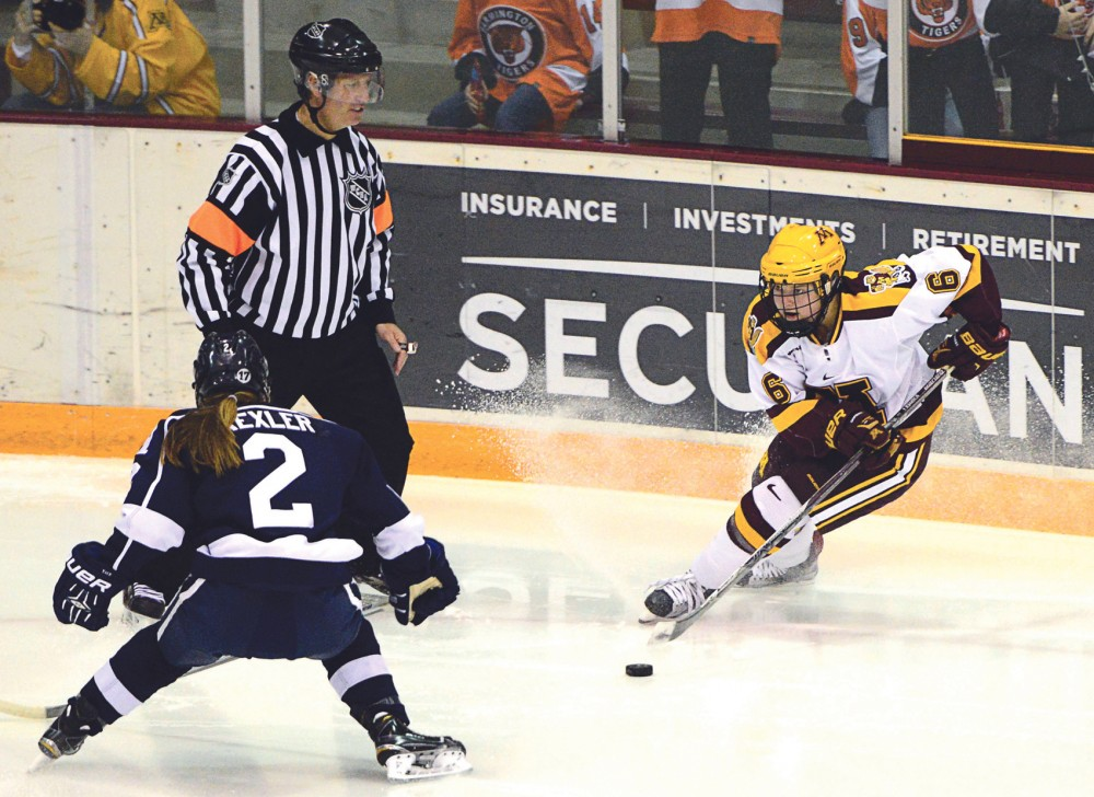 Gophers forward Kate Schipper maneuvers the puck away from a Yale player in Ridder Arena on Nov. 20, 2015.