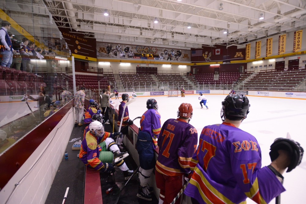 Members of Sigma Phi Epsilon watch their team play in the semifinal of the Lakes and Legends hockey tournament on Saturday, Feb. 4, 2017 at Ridder Arena.