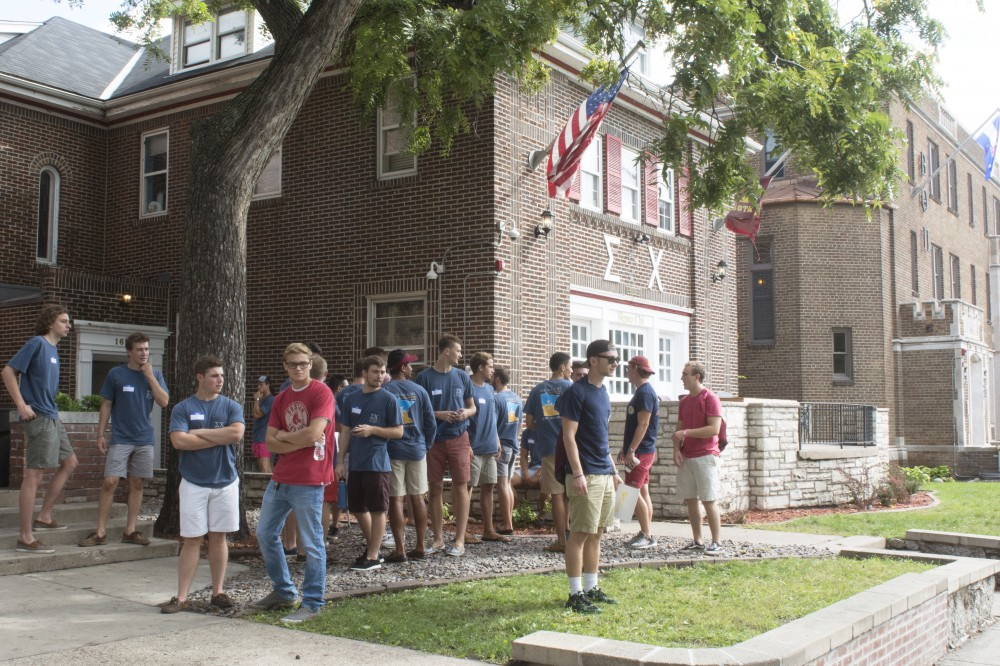 Members of Sigma Chi chat with prospective members during recruitment on Monday, Sept. 5, 2016.