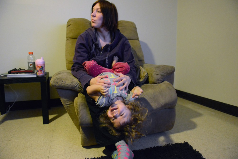 Ashley Crook holds her nearly two-year-old daughter Charlotte in the Glendale Community Townhomes on Friday, Feb. 3, 2017.