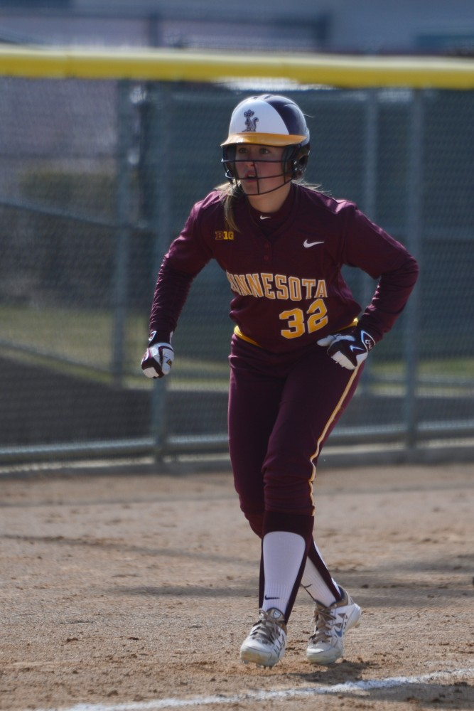Sydney Dwyer edges off third base during the Gophers' home opener double-header against Illinois at Jane Sage Cowles Stadium on April 9, 2016.