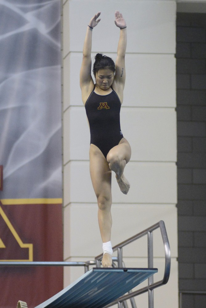 Yu Zhou competes in women's 3 meter diving at the Jean K. Freeman Aquatic Center on Saturday, Feb. 4, 2017 in Minneapolis.