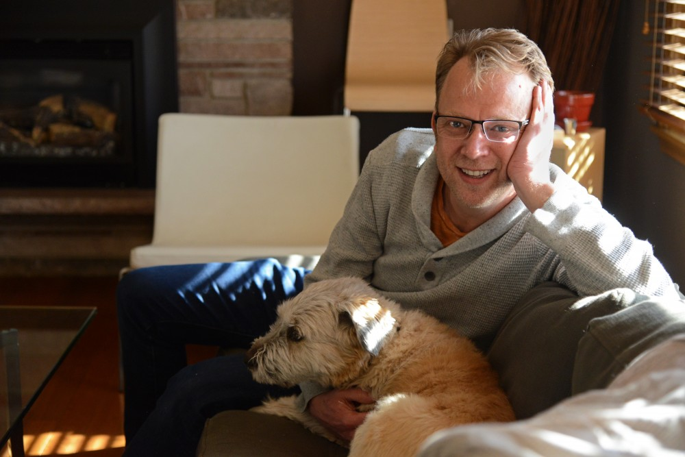 Font designer Chank Diesel poses for a portrait with his dog, London, in his Minneapolis home on Tuesday. Diesel has been designing fonts for nearly 20 years.