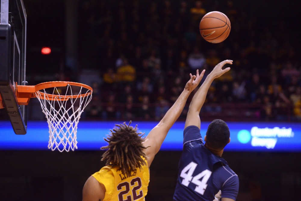 Gophers center Reggie Lynch reaches for a rebound against Penn State on Saturday, Feb. 25, 2017 at Williams Arena.