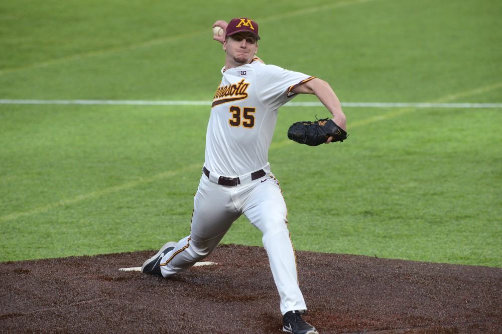 Redshirt sophomore pitcher Reggie Meyer pitches the ball on Sunday, Feb. 26, 2017 at U.S. Bank Stadium. The Gophers won 11-7 against the University of Seattle.