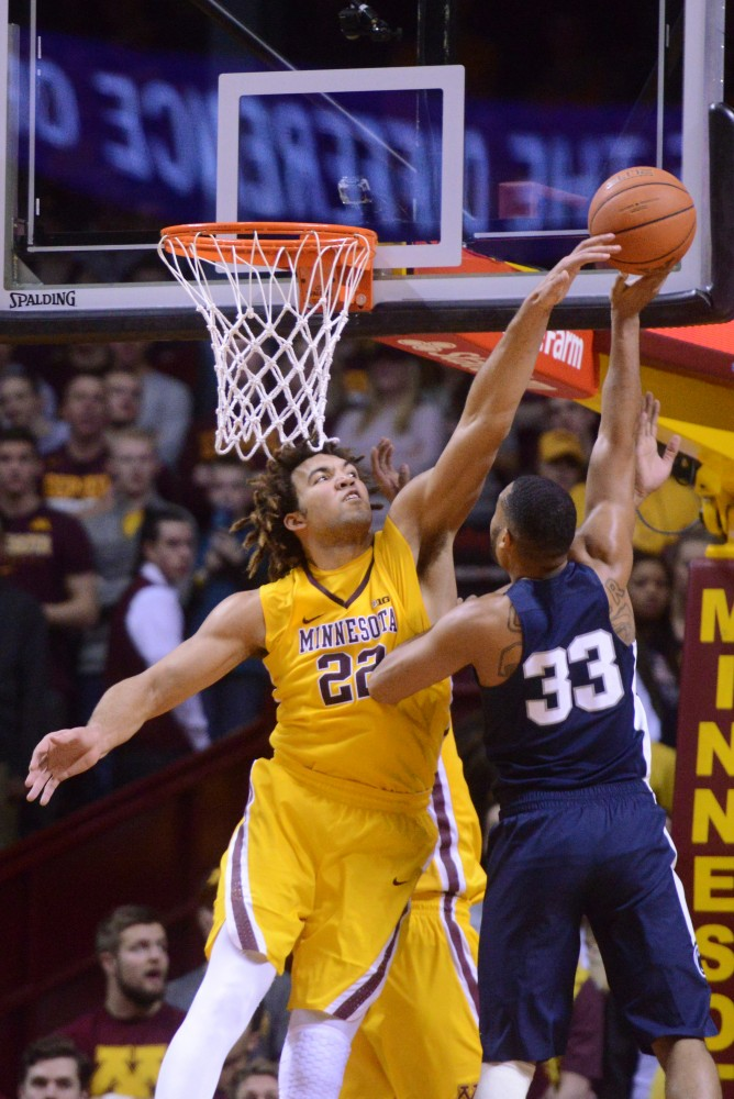 Gophers center Reggie Lynch stuffs a shot against Penn State on Saturday, Feb. 25, 2017 at Williams Arena. Lynch broke the school record for blocks in a season during the game.
