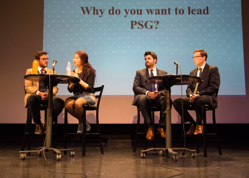Left to right, Michael Blomquist, Sumee Lee, Max Hall and Dane Thompson gather onstage for the Professional Student Government presidential and vice presidential candidate debate on Wednesday in the Coffman Union Theater.