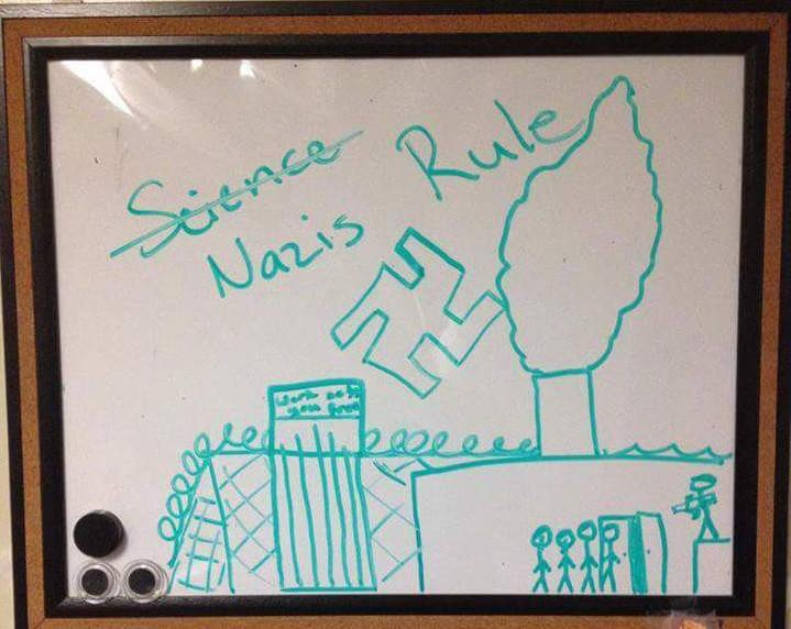 """A swastika with the words """"Nazis Rule"""" drawn on a whiteboard inside aJewish student's dorm room at the University of Minnesota."""