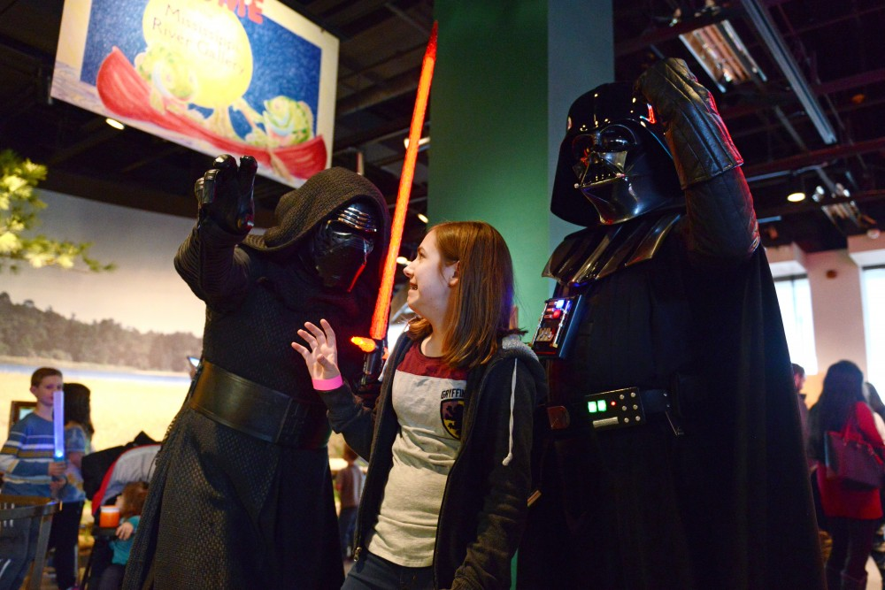 Karolynn Bratten mimics Kylo Rens pose at the Science Museum of Minnesota on Feb. 25, 2017. The museum hosted a Star Wars day that featured activities and events based on the series.