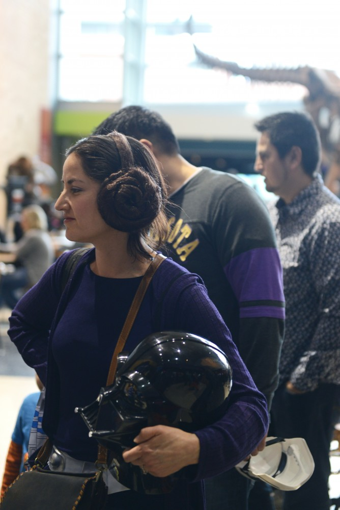 Stephanie Norton waits in line while wearing a Princess Leia hair piece and holding a Darth Vader mask at the Science Museum of Minnesota on Feb. 25, 2017. The museum hosted a Star Wars day that featured activities and events based on the series.