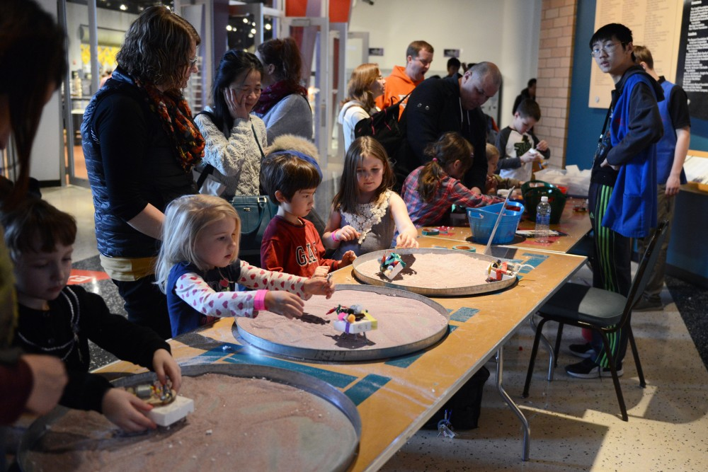 Kids work on creating sand speeders at the Science Museum of Minnesota on Feb. 25, 2017. The museum hosted a Star Wars day that featured activities and events based on the series.