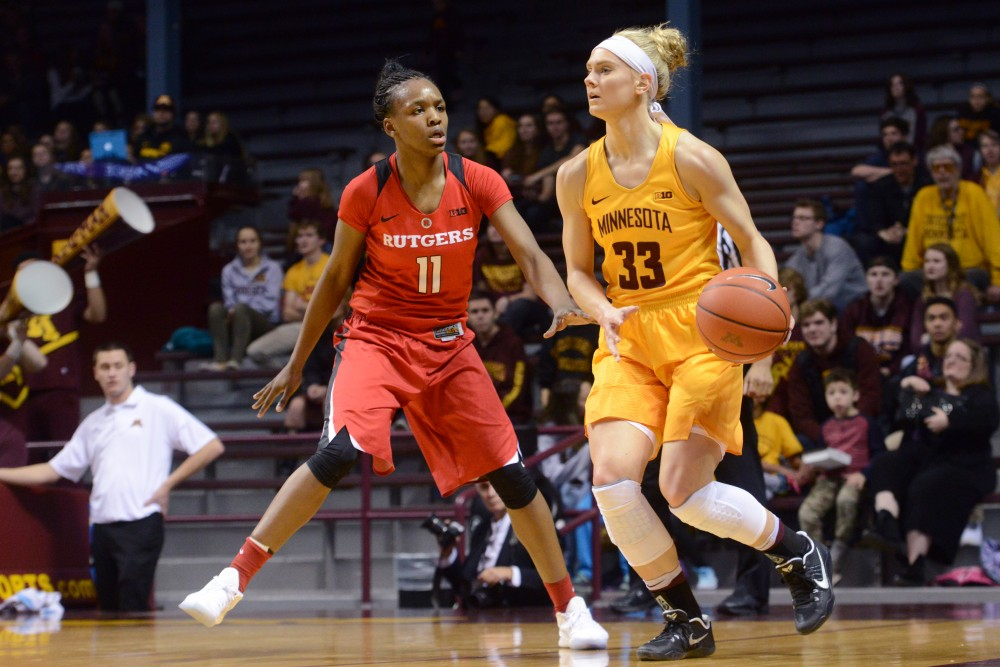 Junior guard Carlie Wagner looks to pass on Saturday Feb. 11, 2017 at Williams Arena. The Gophers won 80-46 against Rutger's University.