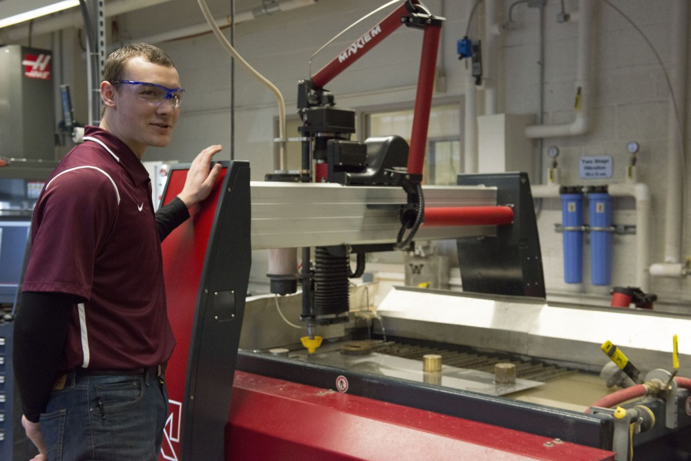 University Mechanical engineering sophomore Evan Humphreys explains the how new waterjet cutter works in one of the Anderson Innovation Labs on Thursday, Mar. 2, 2017. The three new labs, built in Fall of 2016, provide College of Science and Engineering students with the latest equipment to materialize their ideas.